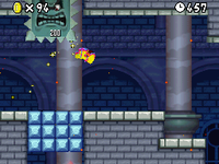 Mario defeating a Big Thwomp as he is in his invincible form in World 4-Castle (New Super Mario Bros.).