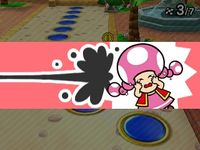 Toadette being hit by a Blooper from Coinathlon in Mario Party: Star Rush