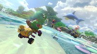 Yoshi driving the Wild Wiggler in Dolphin Shoals of Mario Kart 8