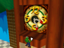 Luigi facing the portal to Tick Tock Clock