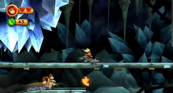 Donkey Kong approaching the third Puzzle Piece of Bombs Away in Donkey Kong Country Returns.