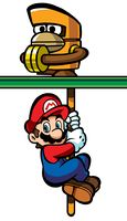 Mario hanging from a Monchee in Mario vs. Donkey Kong.