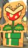 A wooden cutout of a Piranha Plant