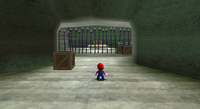 Mario in the caverns in the starting planet in the Beach Bowl Galaxy.