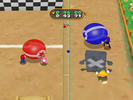 Wario trapped by a Whomp in Sphere Factor from Mario Party 7