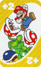 The Yellow Draw 2 card from the UNO Super Mario deck (featuring Mario, Piranha Plants, and a Buzzy Beetle)