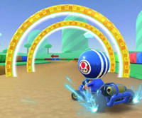 The icon of the Yoshi Cup challenge from the 2021 Yoshi Tour in Mario Kart Tour