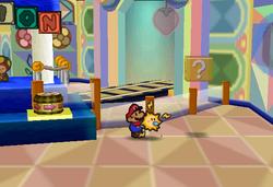 Image of Mario revealing a hidden? Block in Shy Guy's Toy Box, in Paper Mario.