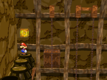Mario next to the Shine Sprite in the storeroom with a! switch in Pirate's Grotto in Paper Mario: The Thousand-Year Door.