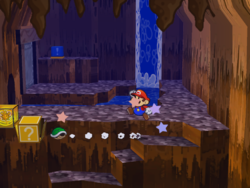 """Screenshot of Mario using Koops to reveal a hidden """"stepping stone""""? Block in Pirate's Grotto, in Paper Mario: The Thousand-Year Door."""