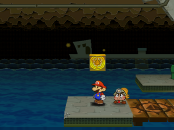 Mario next to the Shine Sprite above the sea on the east of Rogueport Sewers in Paper Mario: The Thousand-Year Door.