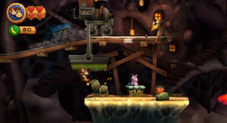 Donkey Kong and Diddy Kong approach the checkpoint of Grip 'n' Trip in Donkey Kong Country Returns