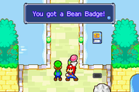 Mario receiving the Bean Badge in Mario & Luigi: Superstar Saga and Mario & Luigi: Superstar Saga + Bowser's Minions