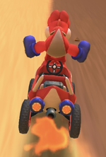 Red Yoshi performing a trick.