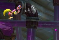 The Kongs using their personal popguns in Donkey Kong Country: Tropical Freeze