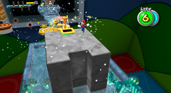Mario near the cannon in the Toy Time Galaxy