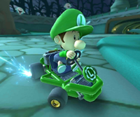 The icon of the Baby Luigi Cup challenge from the 2019 Paris Tour in Mario Kart Tour