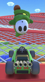 Green Shy Guy performing a trick.