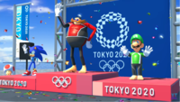 The award ceremony for Surfing in the E3 trailer (left), E3 demo (middle), and final game (right), with differences in the lighting and the direction of the characters' shadows.