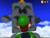 Luigi looking at the Whomp King from Whomp's Fortress.