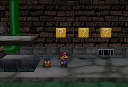 Mario and Goombario in the passage between the entrance and the west areas in Toad Town Tunnels