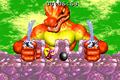 Kerozene holds two Kleevers DKC2 GBA.png