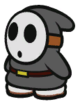 A black Shy Guy in Paper Mario: Color Splash.