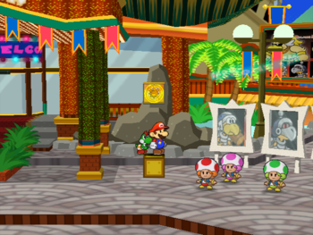 Mario next to the Shine Sprite in the arena of Glitzville in Paper Mario: The Thousand-Year Door.