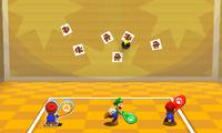 Mario, Luigi and Paper Mario attacking Goombas with Trio Racquet.