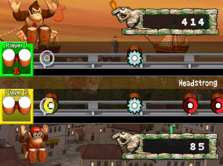 Gameplay of the two-player Battle mode in Donkey Konga 2