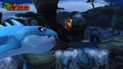 Horror Gills chase Donkey Kong, who rides on a Rocket Barrel.