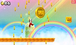 Fire Mario, in Coin Heaven, jumping towards a giant coin.