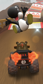 Black Yoshi performs a trick.