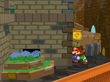 Mario next to the Shine Sprite in the backyard of the rightmost house in the west Rogueport in Paper Mario: The Thousand-Year Door.