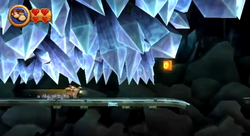 Donkey Kong and Diddy Kong approach the letter O of Bombs Away