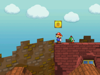 Mario next to the Shine Sprite on the roof of the north house in the east area of Rogueport in Paper Mario: The Thousand-Year Door.