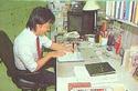 A game designer hard at work working on Super Mario Bros. 3. Scan of Nintendo Power.