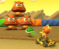 The icon of the Baby Daisy Cup challenge from the Paris Tour and the Yoshi Cup challenge from the Summer Festival Tour in Mario Kart Tour