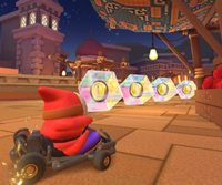 The icon of the Baby Peach Cup's challenge from the New York Tour and the Marine Tour in Mario Kart Tour.