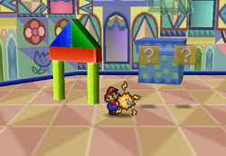 Image of Mario revealing several hidden? Blocks in Shy Guy's Toy Box, in Paper Mario.