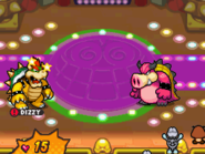 Bowser dizzy during the battle against Midbus in Fawful Theater