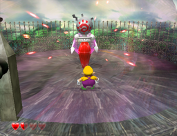Wario fighting a Crystal Entity from Wario World.