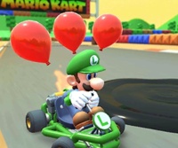 The icon of the Roy Cup challenge from the Exploration Tour and the Dry Bowser Cup challenge from the 2021 Los Angeles Tour in Mario Kart Tour.
