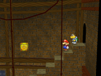 Mario next to the Shine Sprite over the stairs in Riverside Station in Paper Mario: The Thousand-Year Door.