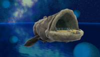 """A screenshot of Bigmouth Galaxy during the """"Bigmouth's Gold Bait"""" mission from Super Mario Galaxy."""