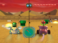 Quicksand Desert arena from Mario Party 5. Boo is driving the vehicle on the right screen.
