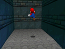 Mario entering the wall of Shifting Sand Land
