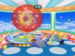Wario blowing up a balloon in Balloon Busters from Mario Party 7