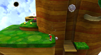 A screenshot of Bee Mario looking for a Comet Medal in the Honeyhop Galaxy.