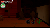 A Toad folded into a cactus inside Big Sho' Theater in Paper Mario: The Origami King